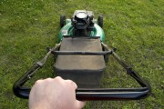 using a power lawn mower to maintain the appearance of a lawn