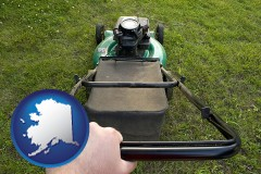 alaska map icon and using a power lawn mower to maintain the appearance of a lawn