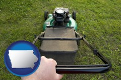 iowa using a power lawn mower to maintain the appearance of a lawn