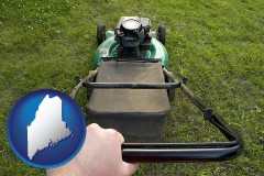 Maine using a power lawn mower to maintain the appearance of a lawn