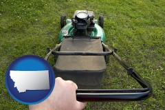Montana using a power lawn mower to maintain the appearance of a lawn
