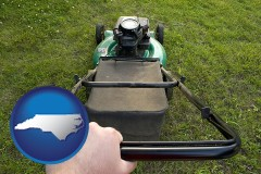 north-carolina map icon and using a power lawn mower to maintain the appearance of a lawn