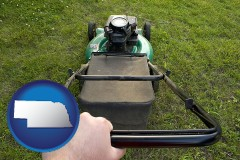 Nebraska using a power lawn mower to maintain the appearance of a lawn