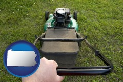 pennsylvania map icon and using a power lawn mower to maintain the appearance of a lawn