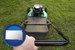 South Dakota using a power lawn mower to maintain the appearance of a lawn