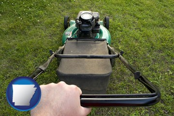 using a power lawn mower to maintain the appearance of a lawn - with Arkansas icon