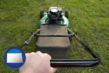using a power lawn mower to maintain the appearance of a lawn - with North Dakota icon