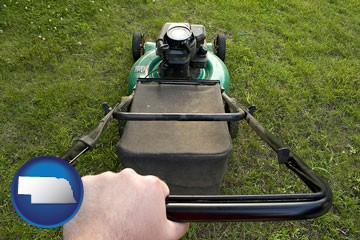 using a power lawn mower to maintain the appearance of a lawn - with Nebraska icon