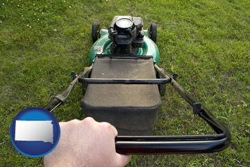 using a power lawn mower to maintain the appearance of a lawn - with South Dakota icon