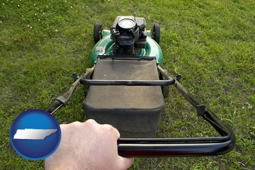 using a power lawn mower to maintain the appearance of a lawn - with Tennessee icon