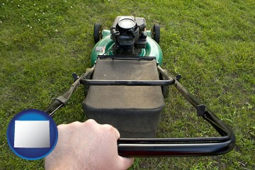 using a power lawn mower to maintain the appearance of a lawn - with Wyoming icon